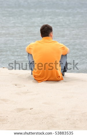 Young man relax on beach - stock photo