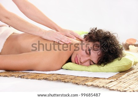 young man relaxing at a spa - stock photo