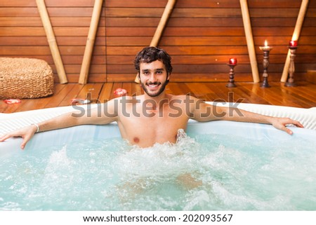 Young man relaxing in a beauty farm - stock photo