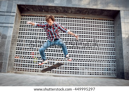 Young man riding a skateboard. Town square - stock photo