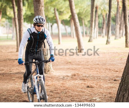 Young Man Riding Bicycle; Outdoors - stock photo