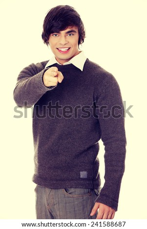 Young man's pointing on you - stock photo