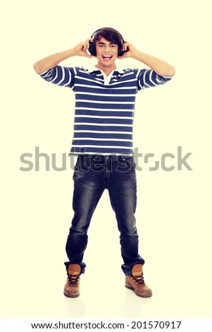 Young man's singing with headphones - stock photo
