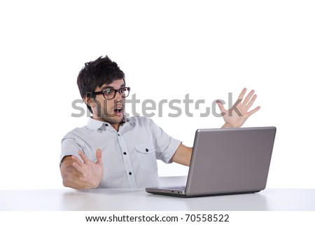 young man scared with something he see on his laptop computer - stock photo