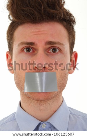 Young man scared with tape on mouth - stock photo