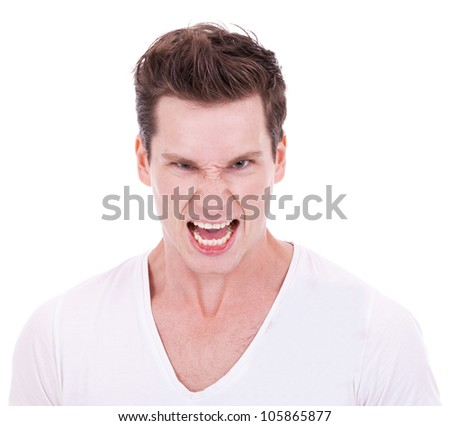 young man screaming at the camera on white background - stock photo