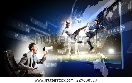 Young man screaming in megaphone and watching football match - stock photo