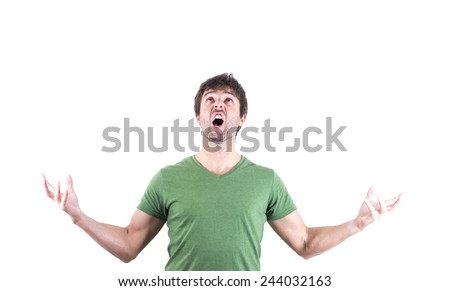Young man screaming up with arms open - stock photo