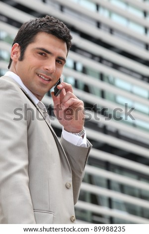 Young man setting an appointment on phone - stock photo