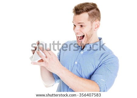 Young man shocked after opening an envelope - stock photo