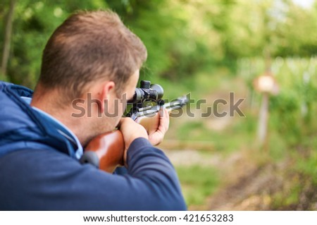 Young man shoot with air rifle.                               - stock photo