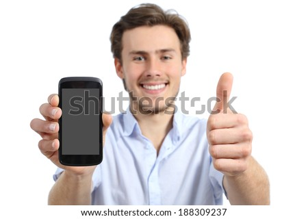 Young man showing a blank smart phone screen with thumbs up isolated on a white background                   - stock photo