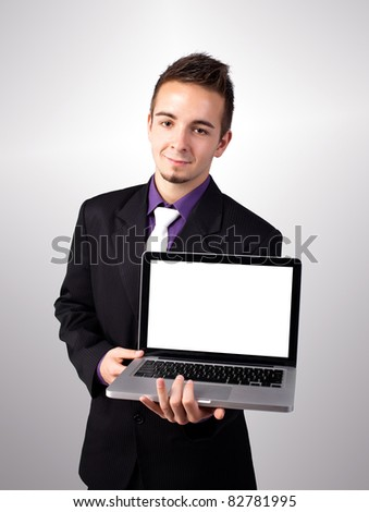 Young man showing a work presentation on the laptop - stock photo