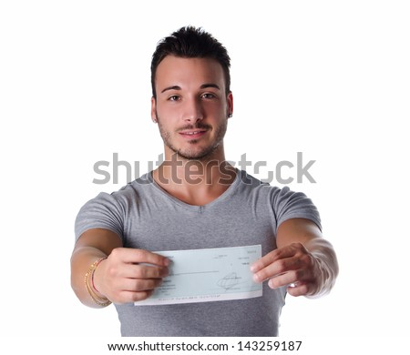 Young man showing check (cheque) in his hands, looking at camera - stock photo