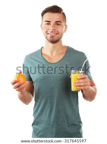 Young man showing glass of orange juice, isolated on white - stock photo