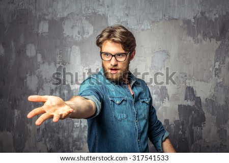 Young man showing hands as a magician - stock photo