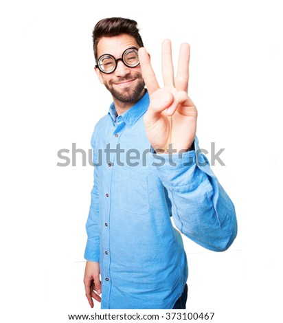 young man showing number three - stock photo