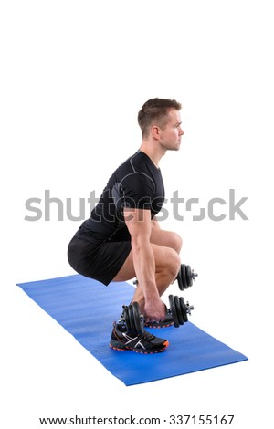 Young man shows finishing position of Squats with dumbbels workout, isolated on white - stock photo
