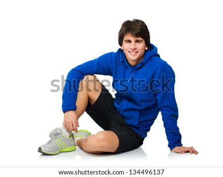 Young Man Sitting On Floor Isolated On White Background - stock photo