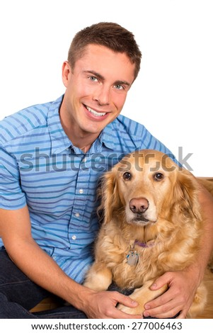 Young man sitting on the floor with his dog - stock photo
