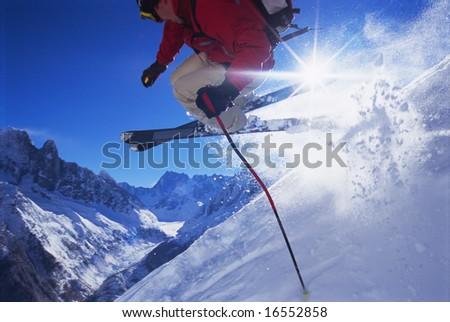 Young man skiing - stock photo