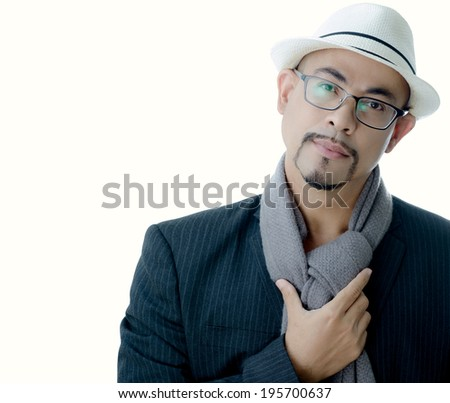 Young man  smart business glasses, white hat  handsome good-looking beautiful mustache look smart international very cool wear black suit ,gray scarf photographer in studio on white isolate background - stock photo