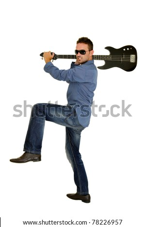 Young man smashing a guitar - stock photo