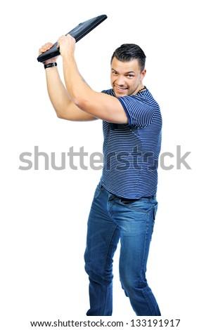 Young man smashing his laptop - stock photo