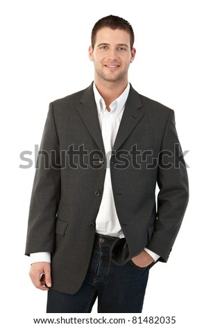 Young man smiling, hand in pocket.? - stock photo