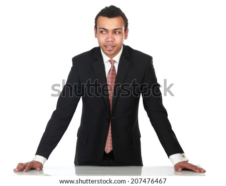 Young man standing near desk, isolated on white background - stock photo