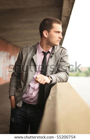 young man standing near handhold - stock photo