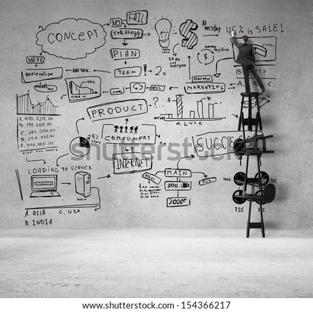 young man standing on stool and drawing business concept - stock photo