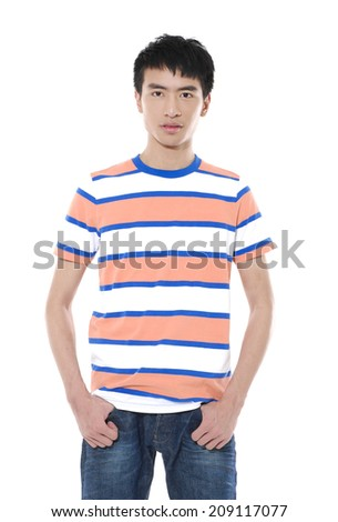 Young man standing with hands  - stock photo