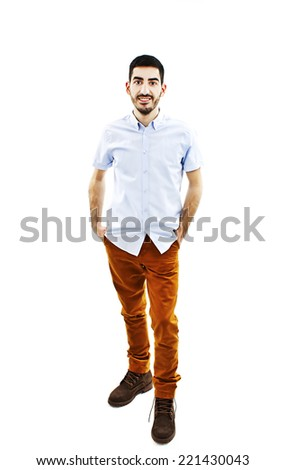 Young man standing with hands in pockets. Isolated on white background  - stock photo