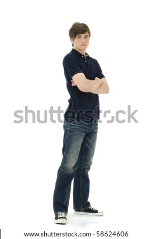 Young man standing with his arms folded - stock photo