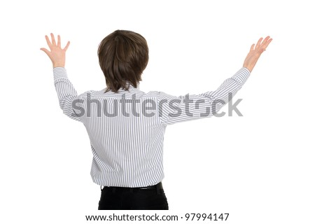 young man standing with his back in delight has spread his hands. - stock photo