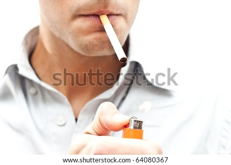 Young man starting smoking - stock photo