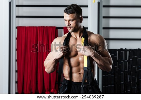 Young man streching muscles making functional training - stock photo