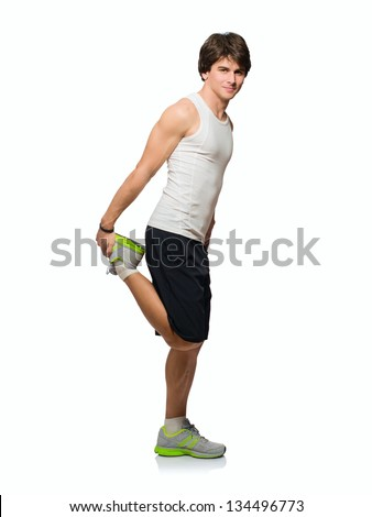 Young Man Stretching His Leg Up Isolated On White Background - stock photo