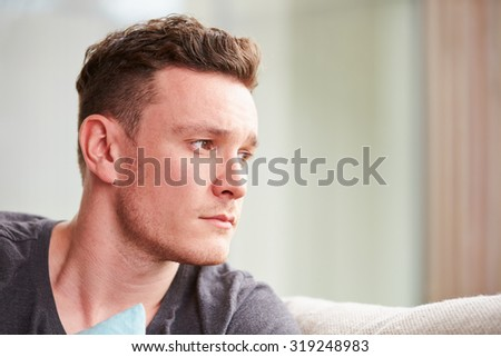 Young Man Suffering From Depression At Home - stock photo