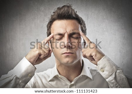 Young man suffering from headache - stock photo
