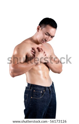 Young man suffering from pain in the chest - stock photo