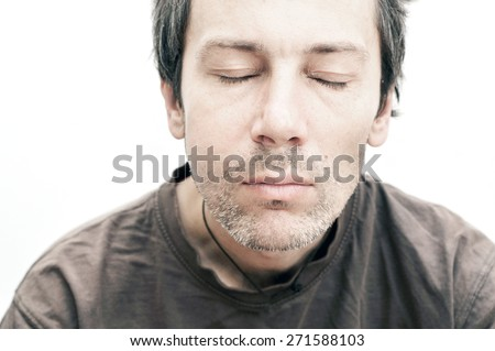 Young man suffering from toothache, teeth pain, swelling face - stock photo