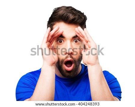 young man surprised - stock photo