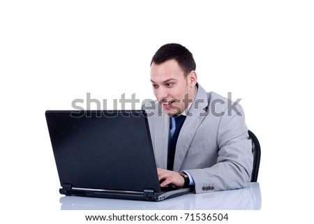 young man surprised and happy with something he see on his laptop - stock photo