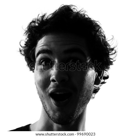 young man surprised silhouette in studio isolated on white background - stock photo