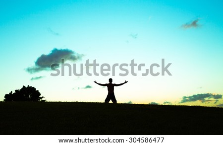 Young man taking in the fresh air in nature and feeling free. - stock photo