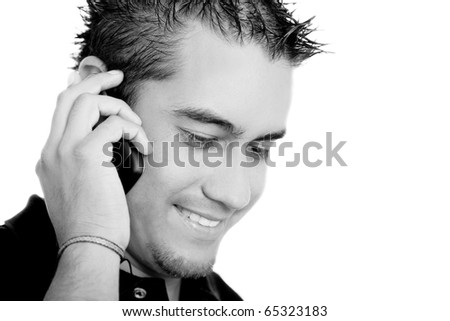 Young man talking on a cell phone on white background, black and white image - stock photo