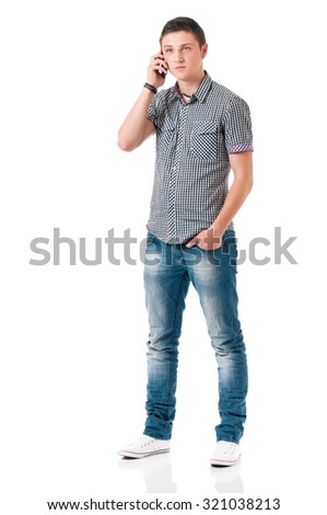 Young man talking on mobile, isolated on white background  - stock photo
