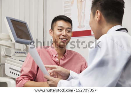 Young Man Talking With Doctor - stock photo